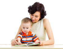 Mother reading a book her son kid Stock Photography