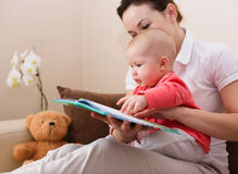 Mother is reading book with daughter Royalty Free Stock Image