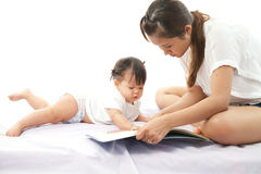 Mother is reading a book Stock Images