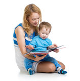 Mother reading book her cute baby boy Royalty Free Stock Photos