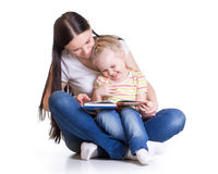Mother is reading book with her daughter Stock Images