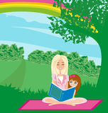 A mother reading a book with her daughter Stock Images