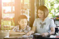 Mother reading a book with her son Royalty Free Stock Photo