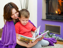 Mother is reading book with her son Royalty Free Stock Photo