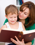 Mother is reading book with her son Royalty Free Stock Images
