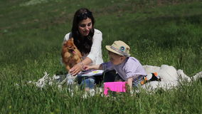 Mother reading a book for her son stock footage