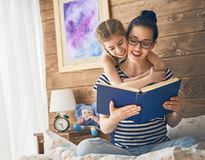 Mother reading a book Royalty Free Stock Image