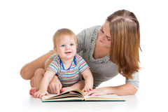 Mother reading book to baby boy Royalty Free Stock Photos