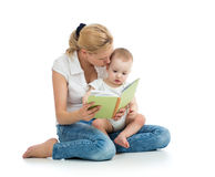 Mother reading book to baby boy Stock Photos
