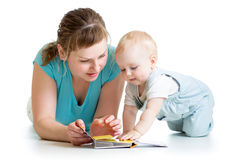 Mother reading a book to baby boy Royalty Free Stock Photos