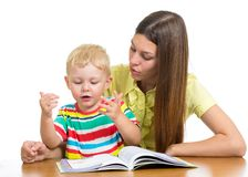 Mother reading a book to child boy Stock Photo