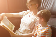 Mother reading the book to the child. Sitting on the floor Royalty Free Stock Images