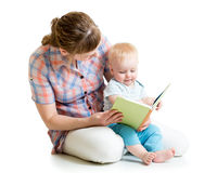 Mother reading a book to her baby Royalty Free Stock Photos