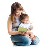 Mother reading a book to her baby boy stock photos
