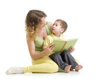Mother reading a book to her kid Stock Photography