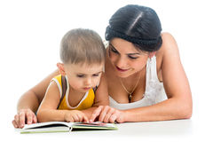 Mother reading a book to her kid Stock Image