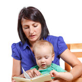 Mother reading a book to his mischievous kid. Isolated on white Stock Photography