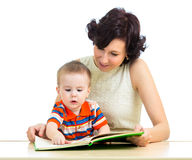 Mother reads book to kid Stock Photos
