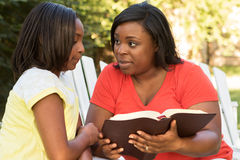 Mother reading with her daughter. Royalty Free Stock Photos