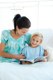 Mother reading with her girl in the hospital Stock Image