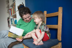 Mother reading with her son at home, casual, Royalty Free Stock Photography