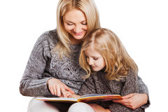 Mother reading with little daughter Stock Photos