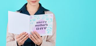Mother reading mother`s day card. Happy Mother`s Day Concept. stock images