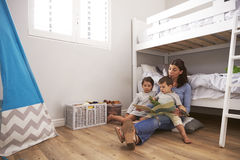 Mother Reading Story To Children In Their Bedroom Royalty Free Stock Images