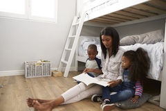 Mother Reading Story To Children In Their Bedroom Royalty Free Stock Photo