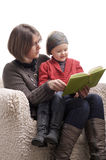 Mother reading a story to her little daughter Stock Photo