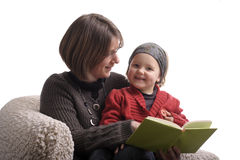 Mother reading a story to her little girl Royalty Free Stock Images