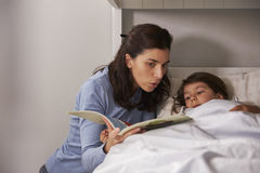 Mother Reading Story To Son At Bedtime Royalty Free Stock Photos