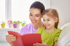 Mother reading to daughter Stock Images