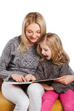 Mother reading with young daughter Stock Images