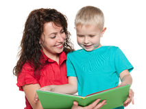 Mother reads book with her son Stock Photography