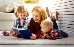 Mother reads book to children. Son and daughter Royalty Free Stock Image