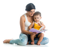 Mother reads a book to her son little boy Royalty Free Stock Images