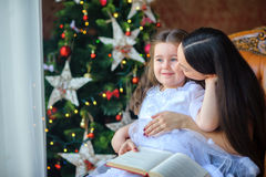 Mother reads fairy tales to the little daughter. royalty free stock photo