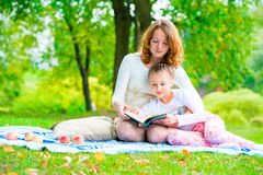 Mother reads her daughter an interesting book Royalty Free Stock Images
