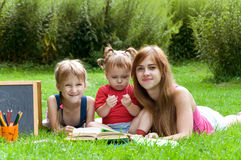 Mother reads to her children an interesting book Royalty Free Stock Image