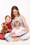 Mother Reads to Kids. Young Mother and pretty child royalty free stock photos