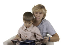 Mother reads to the son the book. Isolated Stock Image