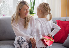 Mother receives present from her child Royalty Free Stock Images