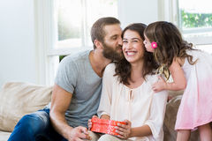 Free Mother Receiving A Gift From Her Husband And Daughter Royalty Free Stock Photos - 69787858
