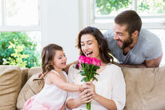 Mother receiving a bunch of flowers from her daughter Royalty Free Stock Image