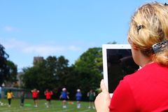 Mother recording sports day Stock Photos