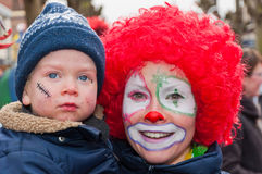 Mother with red wig and child with a blue cap. Royalty Free Stock Photos