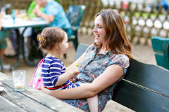 Mother relaxing together with her little child, adorable toddler girl Stock Images