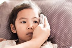 Mother is rubbing the body of sick asian child girl. To reduce the fever with love and care stock photos