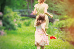 Mother run away from young girl. In the park Stock Photos